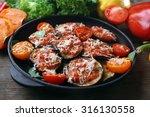 baked and fresh vegetables on...   Shutterstock . vector #316130558
