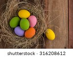 Easter Eggs In Nest On Old...