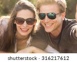couple wearing sunglasses... | Shutterstock . vector #316217612