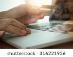 close up of hands using laptop... | Shutterstock . vector #316221926