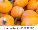 Pile Of Small Pie Pumpkins At...