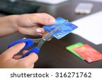 woman's hands cutting bank card ... | Shutterstock . vector #316271762