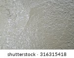 cement on newly paved road | Shutterstock . vector #316315418
