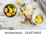 Fresh Raw Potatoes On  A White...