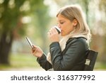 Young Woman Using Tablet In...