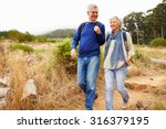 senior couple walking together... | Shutterstock . vector #316379195
