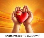 Hands Holding A Broken Hearth ...