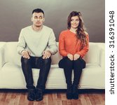 Stock photo shy woman and man sitting on sofa couch first date attractive girl and handsome guy meeting 316391048