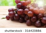 bunch of red grapes on wooden... | Shutterstock . vector #316420886
