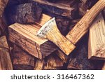 hatchet ax and pile of split... | Shutterstock . vector #316467362