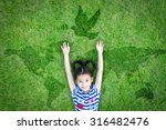 Stock photo happy asian girl child raising hands w happiness lying peacefully w dove birds sign symbol 316482476