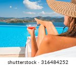 woman relaxing by the infinity... | Shutterstock . vector #316484252