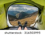 view from inside a tent on the... | Shutterstock . vector #316503995