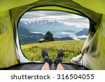 view from inside a tent on the... | Shutterstock . vector #316504055