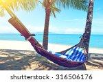 empty hammock between palms... | Shutterstock . vector #316506176