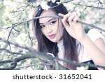 Young woman with cherry flowers portrait. Bright white colors. - stock photo