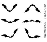 set of bats flying black color... | Shutterstock .eps vector #316567052