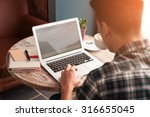 Businessman Using Laptop With...