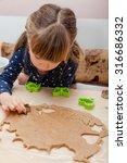 Little Girl Making Stamp...