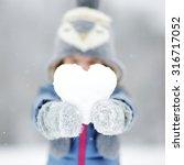 Funny Little Girl Holding Snow...