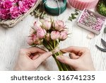 florist at work  woman making... | Shutterstock . vector #316741235