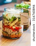 close up of salad in jar | Shutterstock . vector #316760846