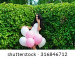 attractive woman with balloons...   Shutterstock . vector #316846712