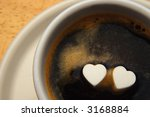 cup of coffee with two hearts on surface - stock photo