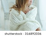 young beautiful woman in warm... | Shutterstock . vector #316892036