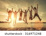 friends jumping on the beach... | Shutterstock . vector #316971248