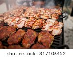 grilling meat with barbecue... | Shutterstock . vector #317106452