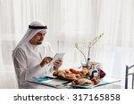 handsome arabian male using... | Shutterstock . vector #317165858