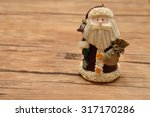 Small photo of A Christmas father figure isolated on a wooden background