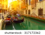 canal with gondolas in venice ... | Shutterstock . vector #317172362