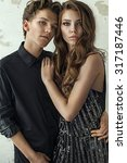 attractive young fashion couple  | Shutterstock . vector #317187446