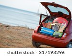 suitcases and bags in trunk of... | Shutterstock . vector #317193296