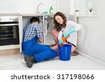 repairman fixing pipe under... | Shutterstock . vector #317198066