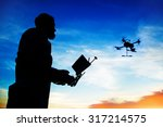 man playing with the drone.... | Shutterstock . vector #317214575