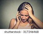 Stock photo portrait unhappy young woman talking on mobile phone looking down human face expression emotion 317246468