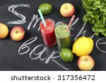 fruit smoothies on a chalk... | Shutterstock . vector #317356472