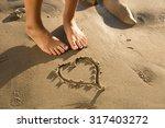 Heart Shape Written In Sand...