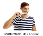 handsome young man holding... | Shutterstock . vector #317470352