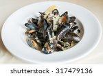 blue mussels white wine sauce  | Shutterstock . vector #317479136