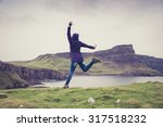 woman jumping on the top of a... | Shutterstock . vector #317518232