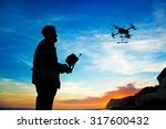 man playing with the drone.... | Shutterstock . vector #317600432