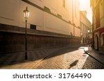 A Sunlit Street In Prague