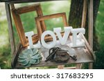 "wooden letters ""love"" are on a... 