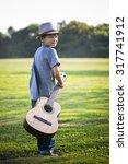 cuacasian boy with guitar in... | Shutterstock . vector #317741912