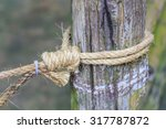 Rope Tied Knot Wood Pole