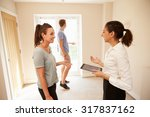 couple viewing a home interior... | Shutterstock . vector #317837162